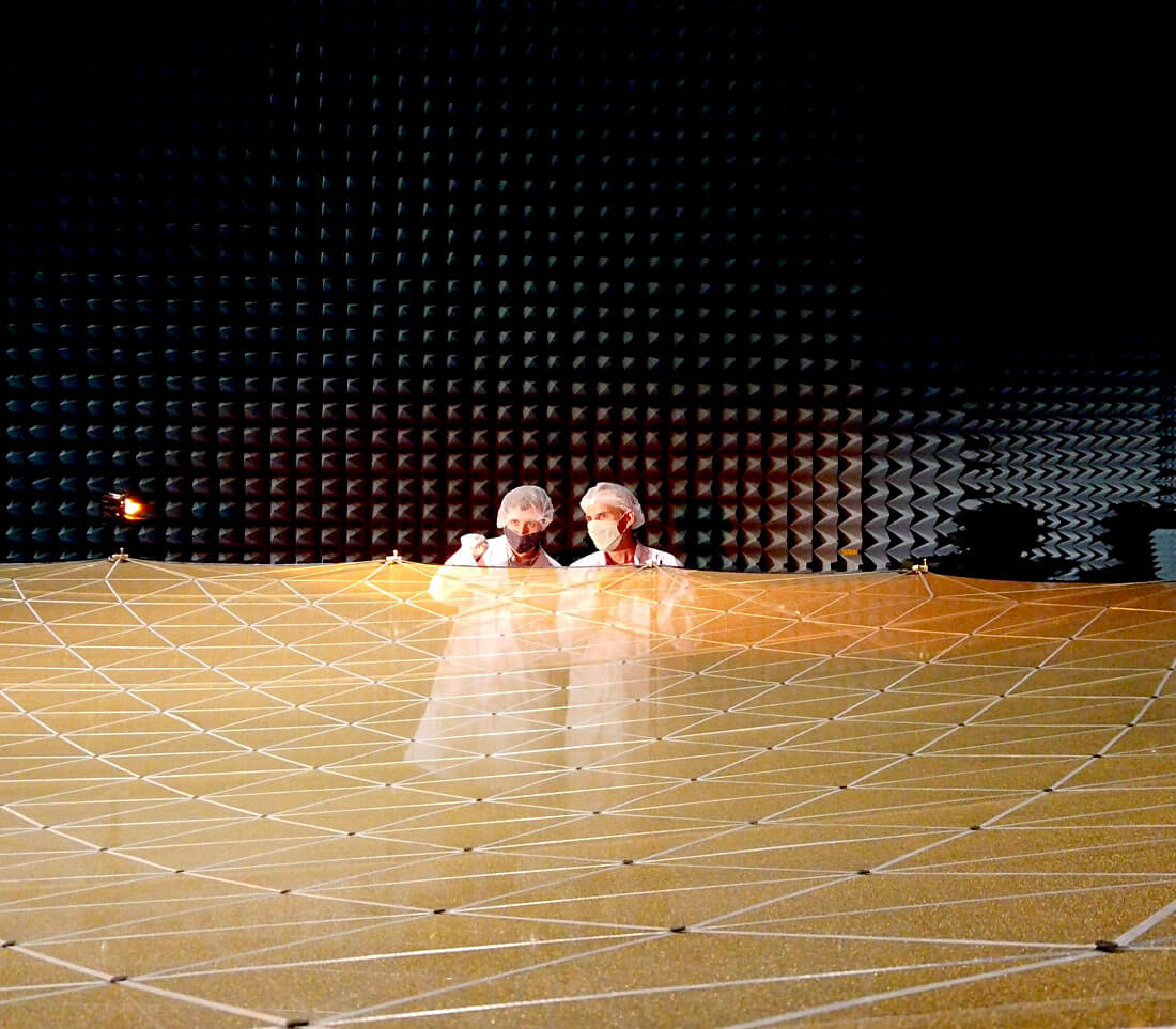 Two scientists examin the space mesh